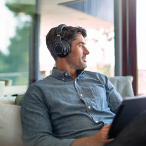 xbbpro_headset_man_couch_laptop.jpg.pagespeed.ic.TRhX-XF2oo