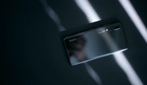 black lenovo smartphone on black surface